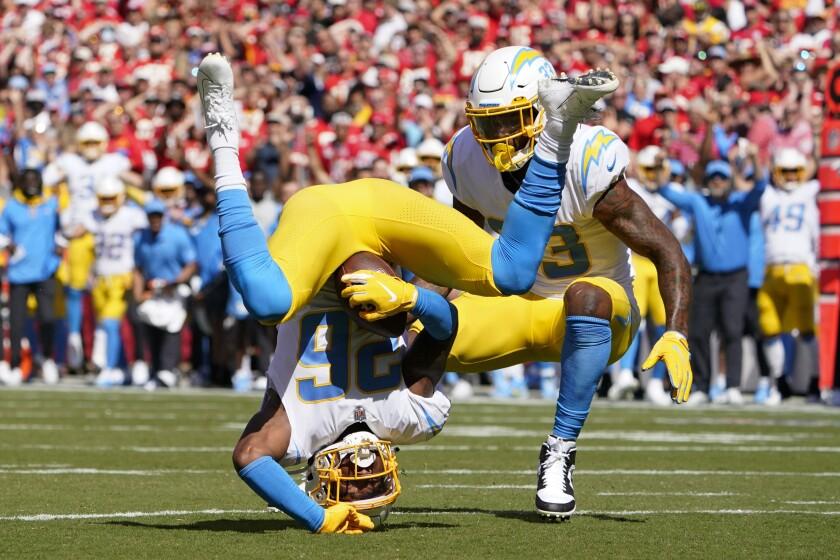 Chargers' Asante Samuel Jr. (26) makes an interception and an awkward landing against the Chiefs.