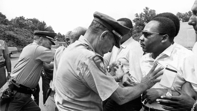 "Mississippi patrolmen shove the Rev. Martin Luther King Jr. and other protesters during the 220-mile ""March Against Fear"" from Memphis, Tenn., to Jackson, Miss., on June 8, 1966, from the documentary ""King in the Wilderness."""