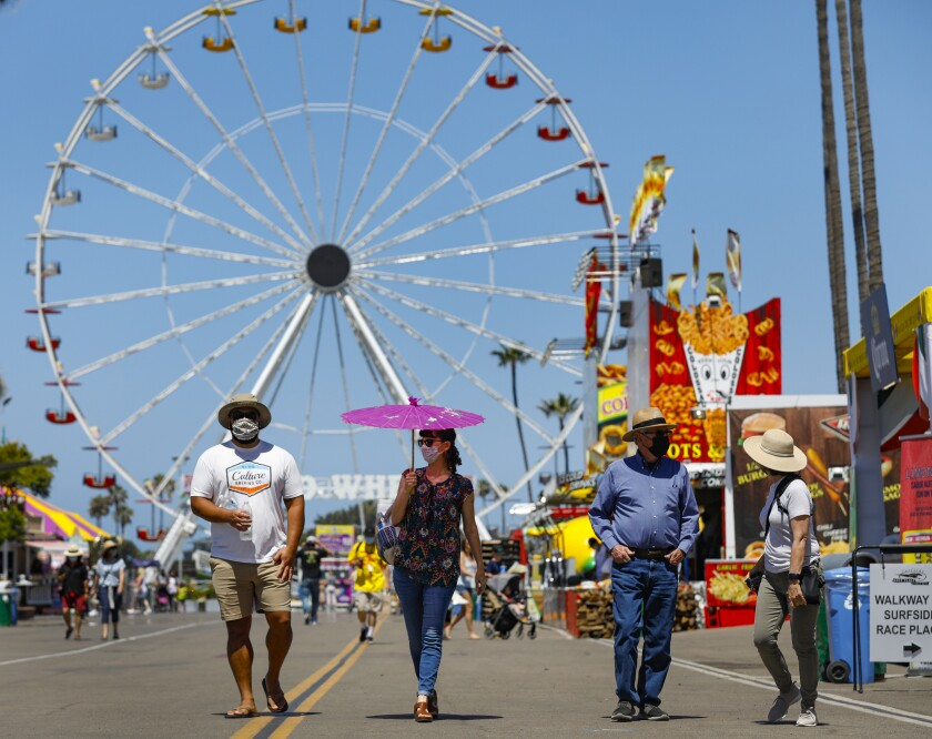 Fair goers take to the midway on opening day for HomeGrown Fun, a scaled-down version of the San Diego County Fair