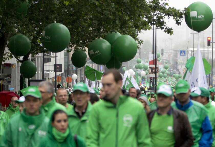 Protestors wave balloons as they march during a demonstration against proposed working regulations in Brussels on Tuesday, May 31, 2016. Public sector employees are striking throughout Belgium, disrupting train and bus service and affecting schools, prisons and delivery of the mail. (AP Photo/Virgi