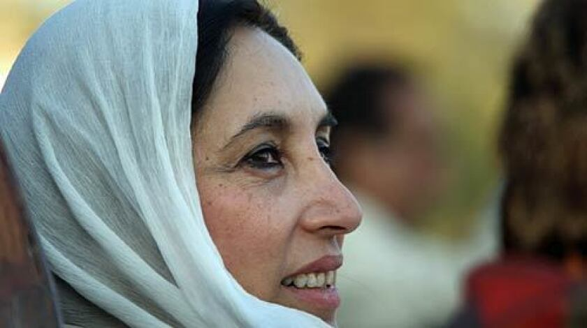 Minutes before her death, former Pakistani Prime Minister Benazir Bhutto gazes towards a crowd of thousands of supporters at a campaign rally.