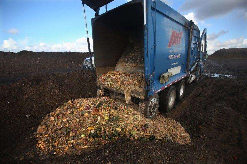 A trash hauler dumps food waste into Miramar Landfill for composting on Dec. 11, 2015. / photo by Peggy Peattie * U-T