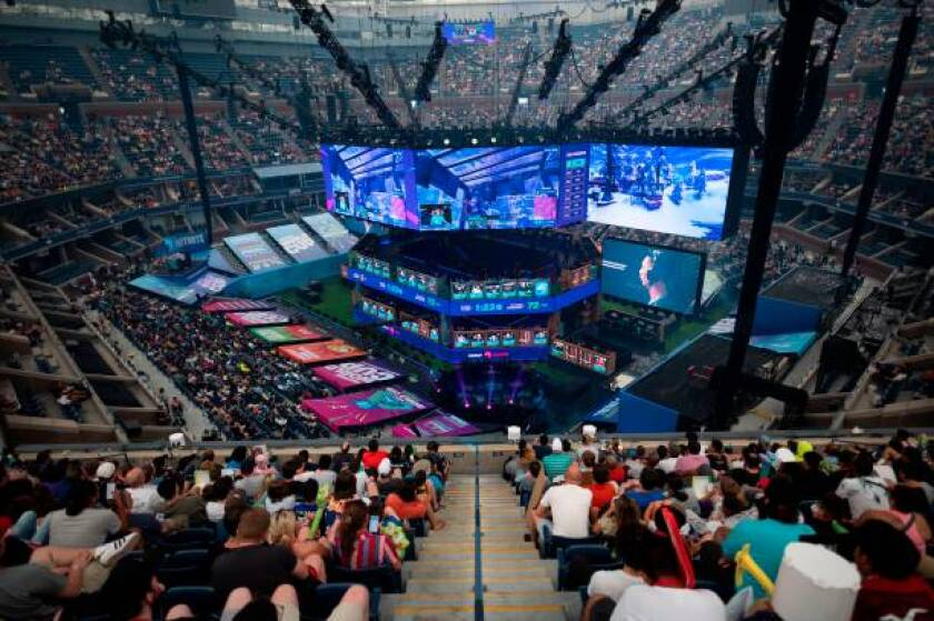 Fans follow the final of the solo competition at the Fortnite World Cup at Arthur Ashe Stadium in New York on Sunday.