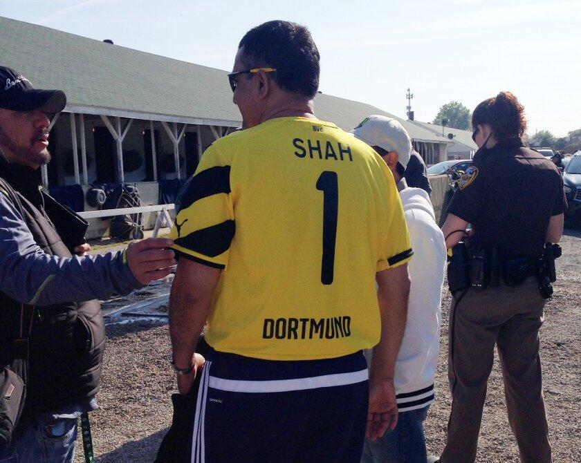 Kaleem Shah, owner of Kentucky Derby hopeful Dortmund, wears the jersey of German soccer club Borussia Dortmund, Wednesday, April 29, 2015, at Churchill Downs in Louisville, Ky. (AP Photo/Beth Harris)