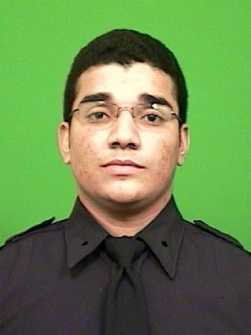 This undated image provided by the New York Police Department shows Dariel Firpo. Firpo, a New York Police Department rookie just couldn't wait to get started. One of the NYPD's newest officers has made his first arrest just minutes after graduating from the Police Academy in a ceremony at Madison Square Garden. (AP Photo/New York Police Dept.)