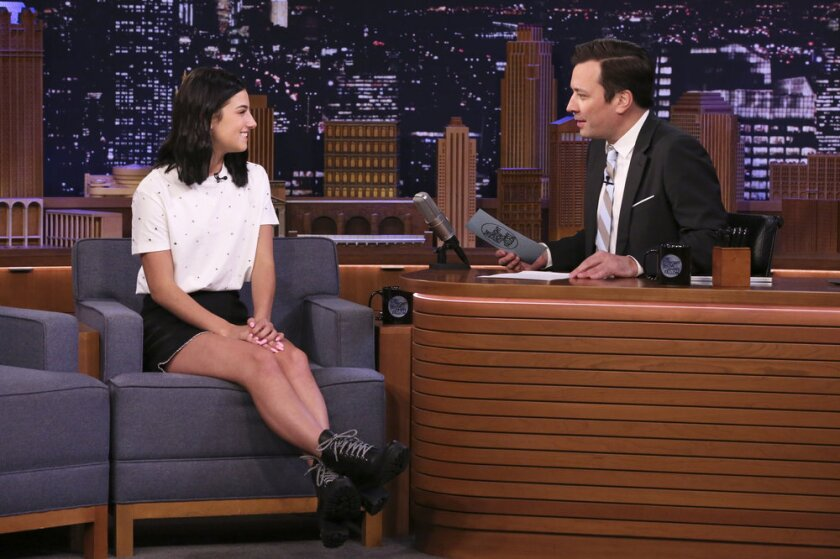 "Dancer Charli D'Amelio sits in a chair for an interview with ""Tonight"" host Jimmy Fallon."