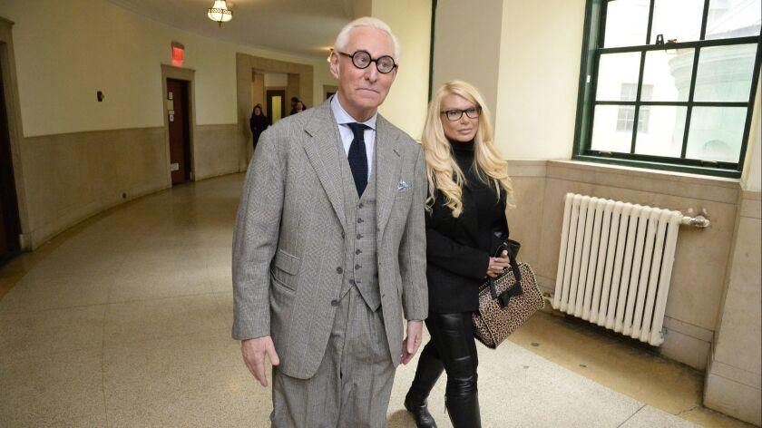 """Roger Stone and Kristin Davis, known as the """"Manhattan Madam,"""" walk in Manhattan Supreme Court on March 30, 2017."""