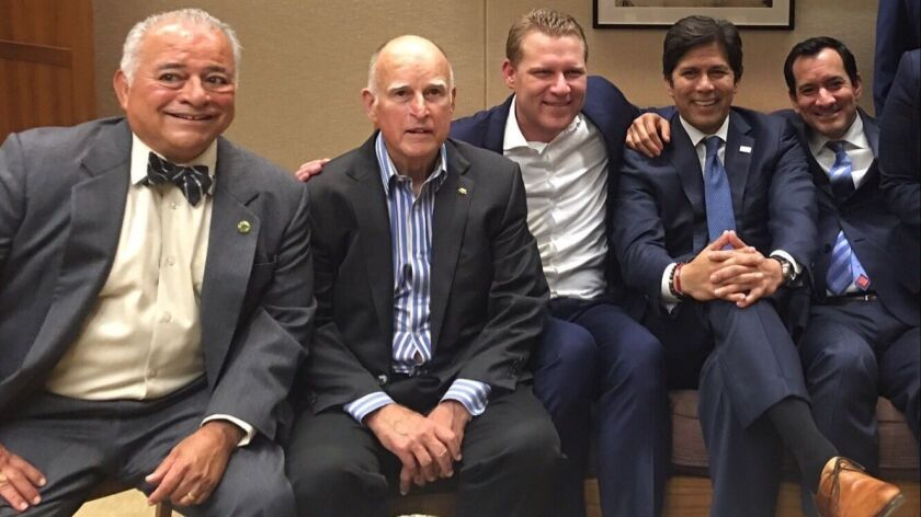 """In a photo one Republican called """"repugnant,"""" Mayes is flanked by Gov. Jerry Brown, Senate leader Ke"""