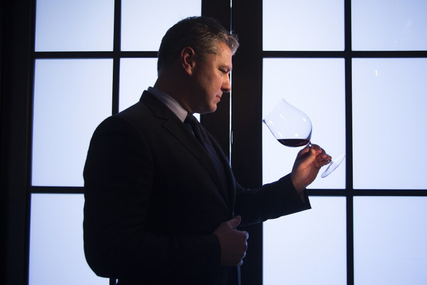 Wine Director Phillip Dunn tilts a glass of 2010 Gevrey Chambertin French burgundy at Spago.