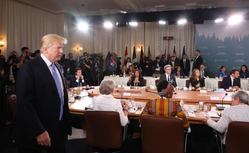 US President Donald J. Trump (L) arrives to attend the G7 and Gender Equality Advisory Council Breakfast at the G7 summit in Charlevoix in Canada 09 June 2018. The G7 Summit runs from 08 to 09 June in Charlevoix, Canada. EFE/EPA