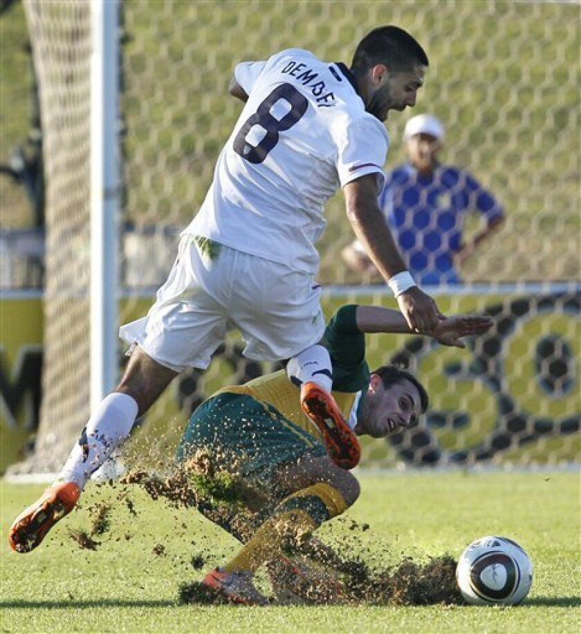 U.S.'s Clint Dempsey (8) and Australia's Luke Wilkshire churn up dirt as they fight for the ball during the second half of a friendly pre-World Cup soccer match at Ruimsig Stadium in Roodepoort, South Africa Saturday June 5, 2010. The U.S. won 3-1. (AP Photo/Elise Amendola)