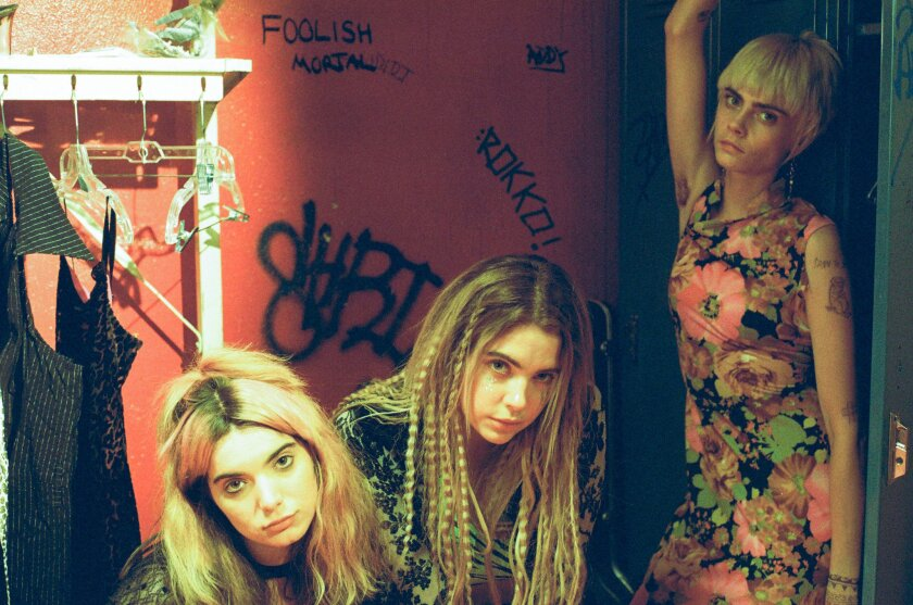 """Dylan Gelula, left, Ashley Benson and Cara Delevingne in a scene from """"Her Smell."""""""