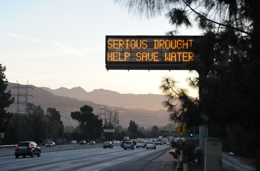 A highway sign in Glendale warns motorists to save water in response to California's severe drought.