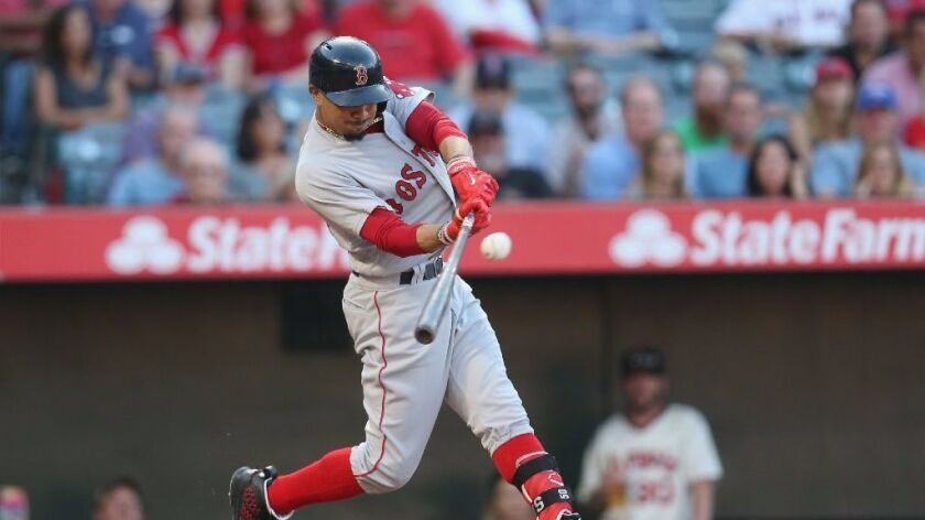 Red Sox outfielder Mookie Betts connects with the ball for an RBI double against the Angels on Satur