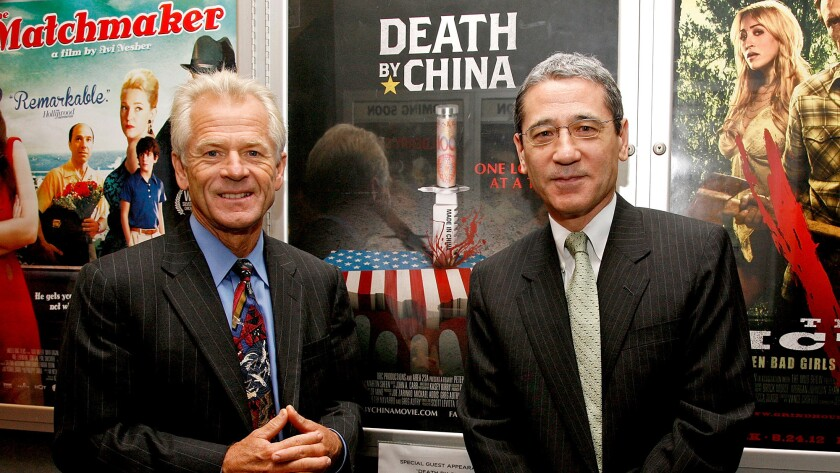 """Peter Navarro, left, and China expert Gordon Chang attend a screening of """"Death by China,"""" the film adaptation of Navarro's book, in New York in 2012."""