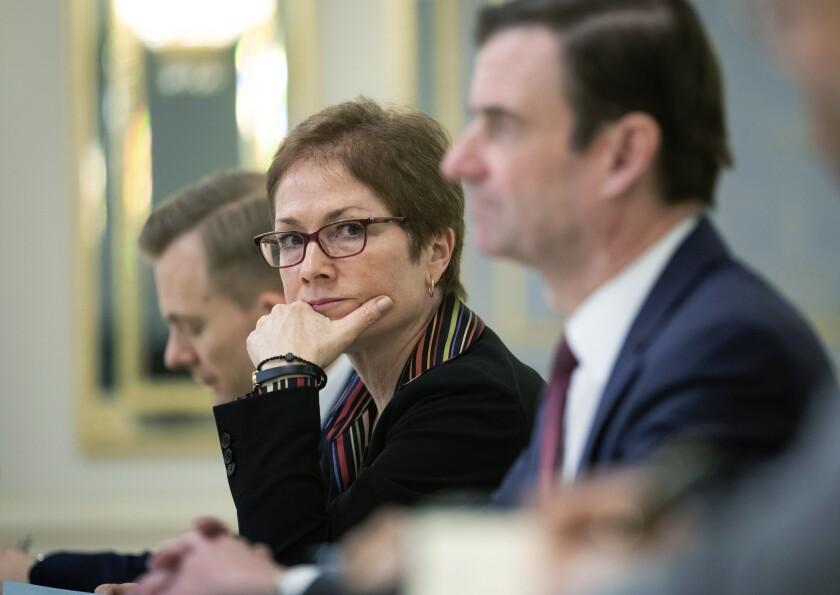 Marie Yovanovitch, former U.S. ambassador to Ukraine, sits beside then-Ukrainian President Petro Poroshenko in Kyiv, Ukraine, on March 6.
