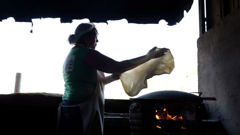 HERMOSILLO, MEX-JUNE 18, 2019: Ramona Ruiz prepares sobaqueras, an extra-large tortilla, at Tortilla