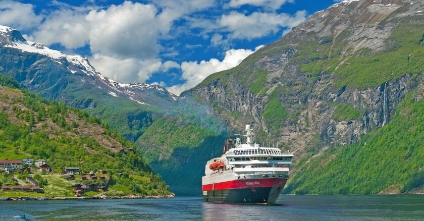 Hurtigruten sails in Geirangerfjord, Norway, a UNESCO-protected area.