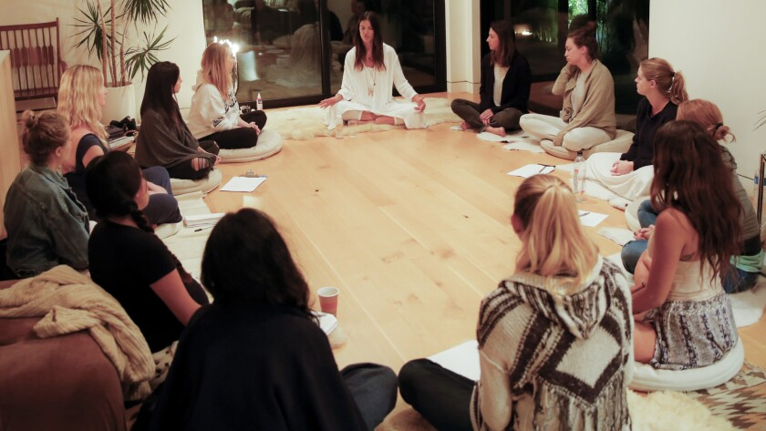 """A group of women gather in the Venice home of Paula Mallis for a """"New Moon"""" ceremony."""