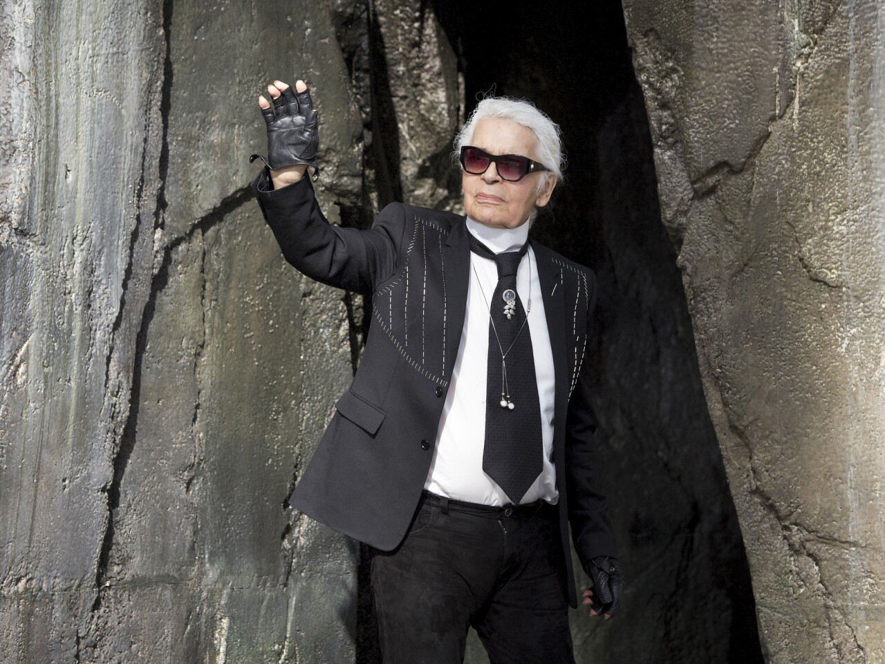 Karl Lagerfeld acknowledges the audience during the Chanel show as part of Paris Fashion Week in October 2018.