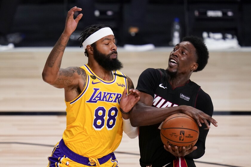 Lakers forward Markieff Morris pressures Heat center Bam Adebayo during the first half of Game 4 on Oct. 6, 2020.