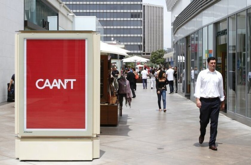 """The Westfield Century City mall has been plastered with advertisements -- several dozen -- that poke fun at talent agency CAA. The ads say """"CAAN'T"""" and are written in the iconic CAA font and color."""