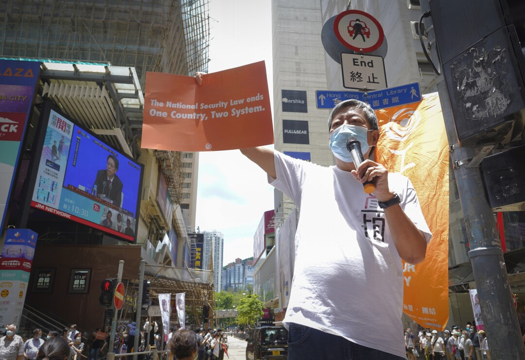 Activist Lee Cheuk-yan participates in a demonstration in Causeway Bay before the annual July 1 handover march in Hong Kong.