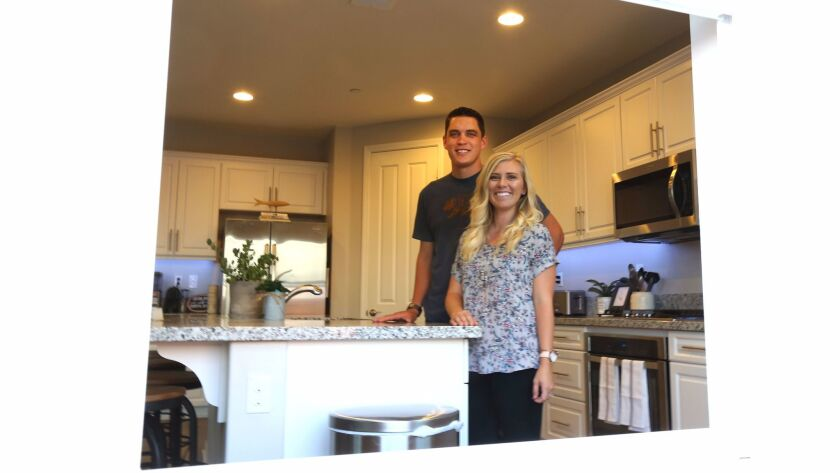 Josh and Kayleigh Hyink stand in the kitchen of their new home in Murrieta.