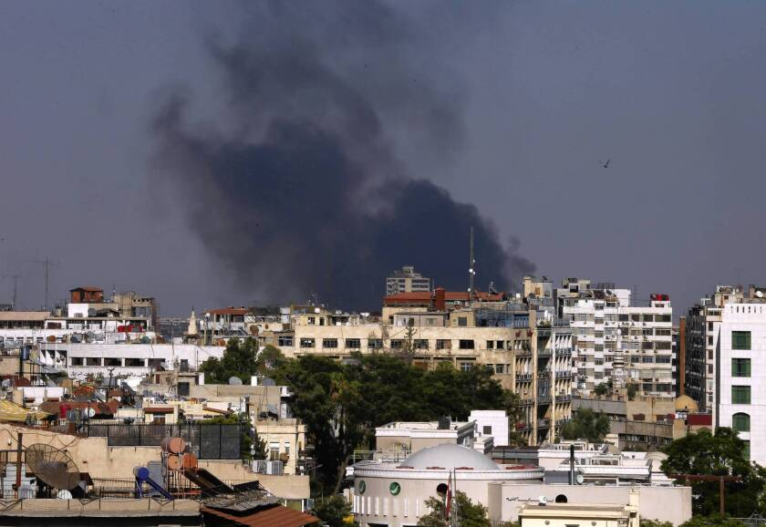 Smoke rises from heavy shelling in Jobar, a suburb east of Damascus, Syria. Activists and residents say the eastern suburbs are facing extreme food and medicine shortages.
