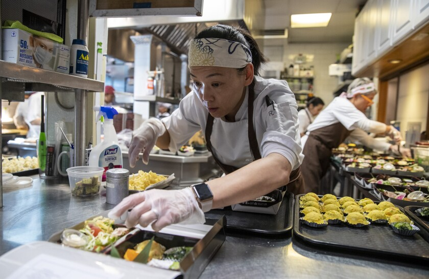 Carole Iida-Nakayama prepares $38 bento boxes at n/naka on Tuesday. Dinner at the Palms kaiseki restaurant, one of the hardest-to-score reservations in town, normally costs $275.