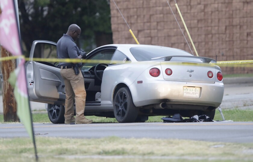 Officers investigate the scene of a shooting where two Tulsa Police Officers were shot Monday, June 29, 2020, in in Tulsa, Okla. (Mike Simons/Tulsa World via AP)