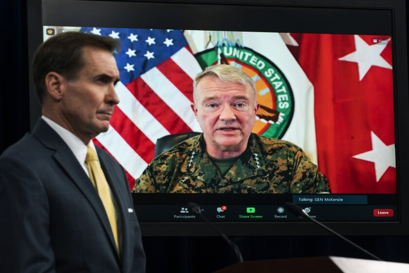 Gen. Frank McKenzie, commander of U.S. Central Command, appears on screen from MacDill Air Force Base, in Tampa, Fla.