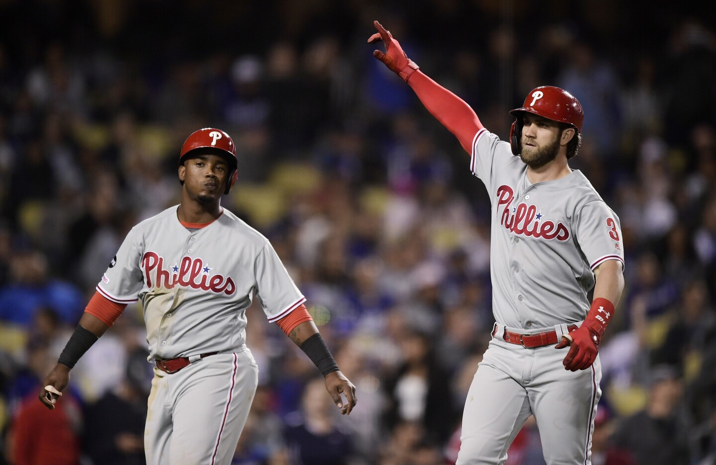 Philadelphia Phillies' Bryce Harper, right, gestures after hitting a two-run home run, next to Jean Segura, during the seventh inning of the team's baseball game against the Los Angeles Dodgers on Saturday, June 1, 2019, in Los Angeles. (AP Photo/Mark J. Terrill)