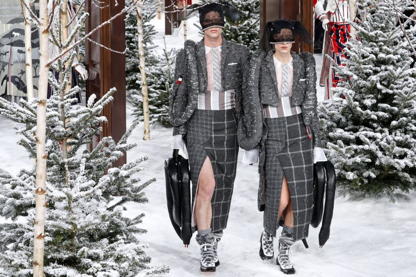 Thom Models representing the two snakes headed for Noah's Ark (note the pebble-grain black leather handbags shaped like snakes) are the last of 33 animals represented in Thom Browne's fall and winter 2020 men's and women's runway show. AW20