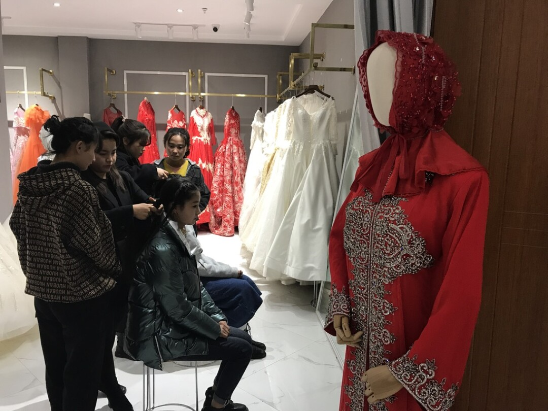 Young Dongxiang women receive training to become bridal hair and makeup artists at a vocational school.