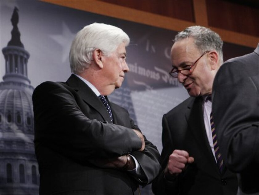 Senate Banking Committee Chairman Sen. Christopher Dodd, D-Conn., left, speaks with Sen. Charles Schumer, D-N.Y., on Capitol Hill in Washington, tuesday, Nov. 10,2009, where they announced a financial reform package. (AP Photo/Charles Dharapak)