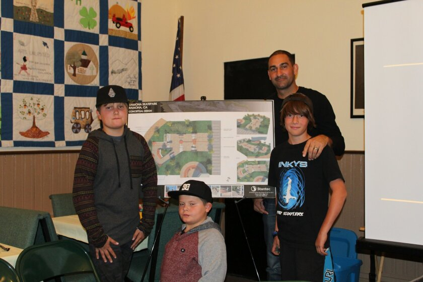 Former professional skateboarder Kanten Russell, now a skatepark designer, stands by a concept drawing of a skatepark for Ramona with Miles and Reed Gunnett and Dillon Webster.