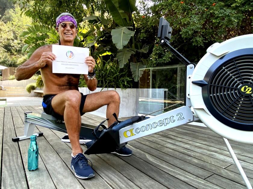 Mitch Besser, philanthropist husband of singer Annie Lennox, at his rowing machine.