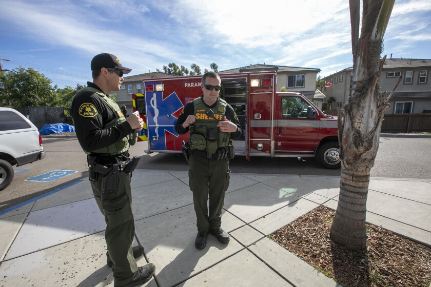 Members of a San Diego County Sheriff Homeless Outreach Team