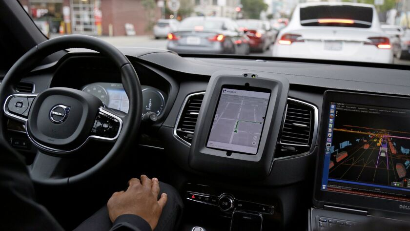 A Volvo equipped with self-driving technology inches through traffic in San Francisco.