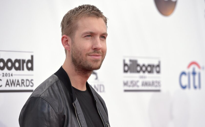 Calvin Harris arrives at the Billboard Music Awards at the MGM Grand Garden Arena on Sunday, May 18, 2014, in Las Vegas. (Photo by John Shearer/Invision/AP)