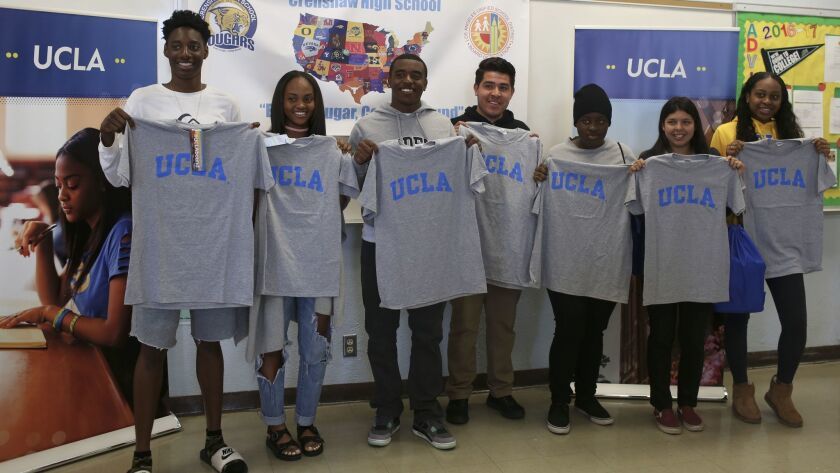 Seven prospective UCLA students from Crenshaw High School at an event meant to sway them to attend t