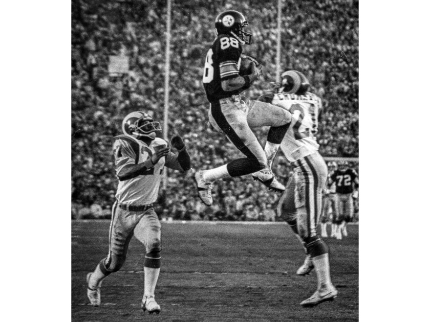 Jan. 20, 1980: Lynn Swan catches a 47-yard third quarter touchdown pass from Terry Bradshaw giving Pittsburgh a 17-13 lead. Rams defenders are Pat Thomas, left and Nolan Cromwell.
