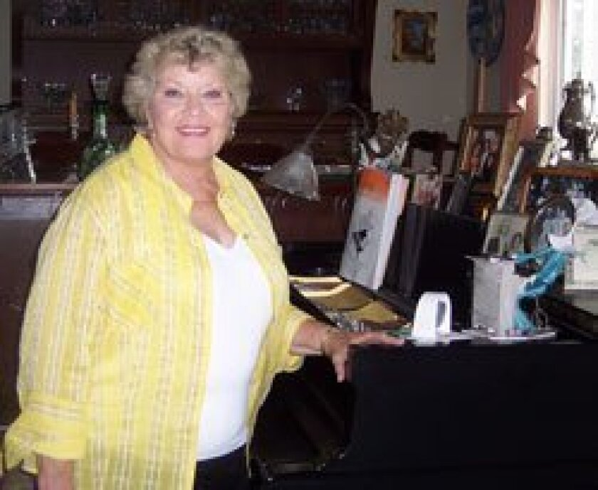 Patti Page at the piano of her Solana Beach home   Photo/Diane Y. Welch