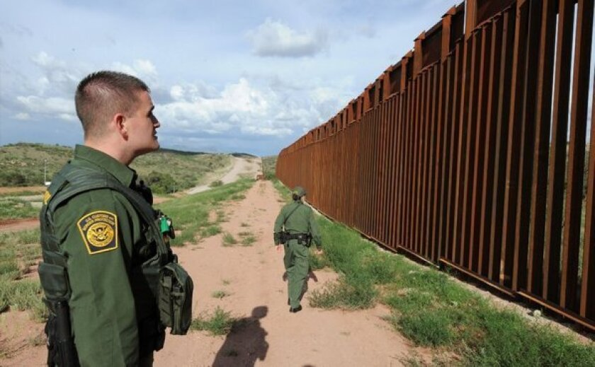 An immigration reform bill that passed the Senate has languished in the House. Above, U.S. Border Patrol agents in Nogalez, Ariz., work along the U.S.-Mexico border.