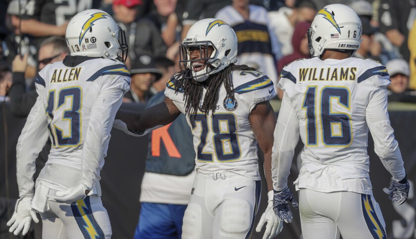 Chargers running back Melvin Gordon celebrates with teammates Keenan Allen and Tyrell Williams after scoring a touchdown against the Raiders on Nov. 11.