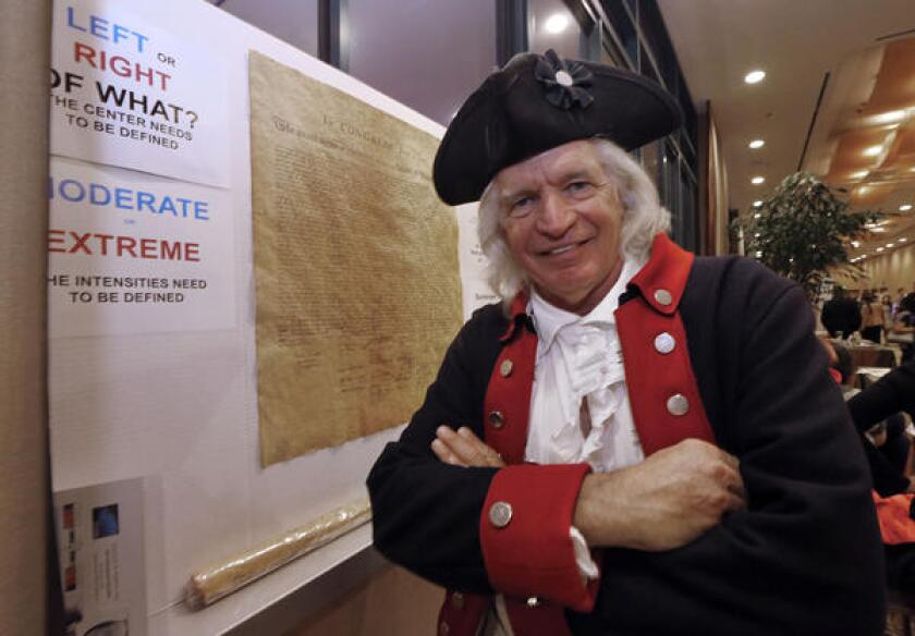 Author Steven Maikoski poses as George Washington next to a replica of the Declaration of Independence during last month's state Republican party convention in Anaheim.