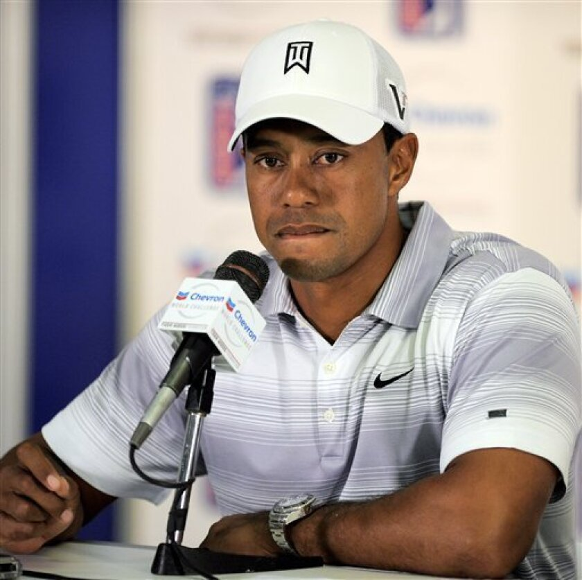 Tiger Woods listens to a question during a news conference for the Chevron World Challenge golf tournament at Sherwood Country Club, Wednesday, Nov. 30, 2011, in Thousand Oaks, Calif. (AP Photo/Mark J. Terrill)