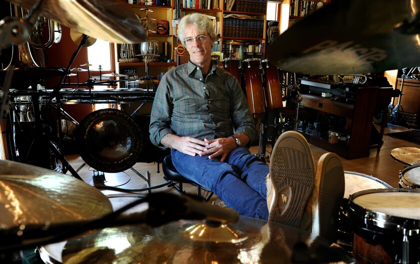 Police drummer Stewart Copeland, shown in his Brentwood studio, wants fans to jam with him over the Internet.
