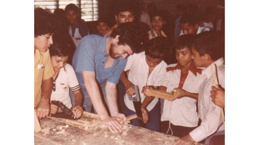 Tim Kaine, the future U.S. senator and vice presidential candidate, works with carpentry students in El Progreso, Honduras, in 1980.